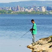 Person fishing on Onondaga lake