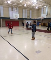Kids having fun Skating in gym