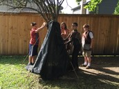 5th Grade students building shelter