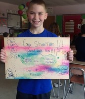 Patrick created a poster to cheer his sister on!