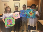 Students from Ms. Swingle's  art class show off their symmetrical artwork!