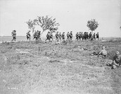soldiers walking on a trail