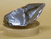 Silicon (atomic number 14 atomic symbol Si).