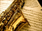 Alto Saxophone with Sheet Music