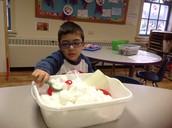 Aaron had fun playing in the cloud, sun, star, rain sensory bin