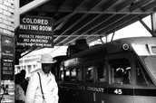African-American Man Stands At Subway Stop