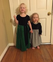 Little Emsoffs showing off new dresses.