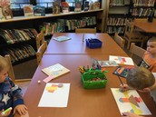 Kindergarteners use shapes to make Lois Ehlert-inspired creations!