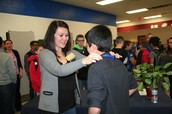 Brandon Li receiving his second place ribbon from Mrs. Wittmus