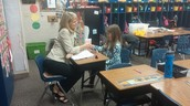 2nd graders hard at work interviewing for jobs with the popcorn company.