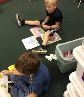 Mrs. Christy's class looking at books.