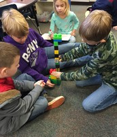Burkes' class is measuring Legos in inches.