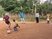 Material ( soccer ) Picture of Robby Glass playing soccer with kids.
