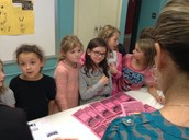 Third graders educate their parents and other guests.
