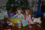 Boy and girl opening presents together