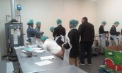 BA students packaging food items for Harvest Hope Food Bank