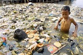 Kid Bathing / Swimming In A Polluted Pond