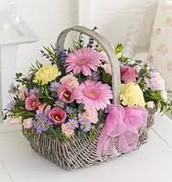 Baskett Arrangement with Pink and purple flowers and yellow accent carnations
