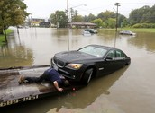 Man going to the rescue of his car