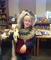 Trying on Native American artifacts