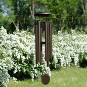 A wind chime mobile in a backyard