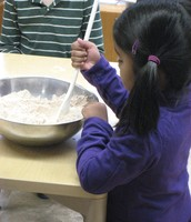 Mixing dough for gingerbread cookies