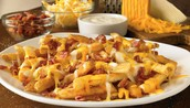 las Papas fritas con queso y tocino