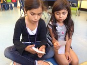 Mia and Isabella buddy reading word lists.  We always give such kind compliments.