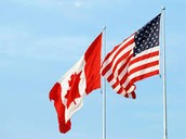 Canada's flag and the U.S's flag