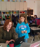Mrs. Whitenack and Jamie work on fixing a link!