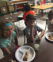 New 1st graders enjoyed a pizza lunch with Mrs. Sauer.