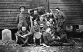 Soldiers in front of training camps smiling