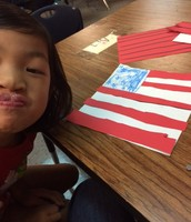 Silly girl making September 11 Flags