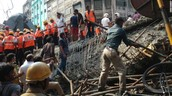 Rescue workers and residents work to clear the rubble.