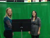 Ms. Sheppard & Mrs. Hrunek try out the green screen on inservice day