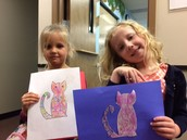 Jersey and Katelyn displaying their abstract art cats