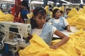 Kids sewing clothing in a sweatshop