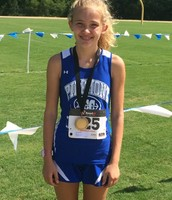 Mari Jablonski places first for the Cougar Cross Country Team