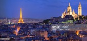 """Panoramic view of the Sacre Coeur basilica, Montmartre and illuminated Eiffel Tower at night"""