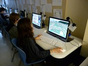 students working on minecraft for a school  project.