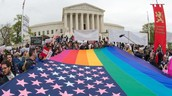 The flag in this picture represents same sex marriage and all the people that support the newly law passed in 2015.