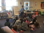 Reading poetry as Mrs. Hicks's models a poem for the students.