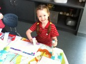 Isla representing her pattern using colours