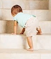 Baby walking up the stairs