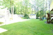 Large quite beautiful back yard with inground pool.