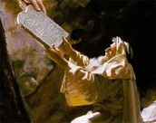Moses receiving the Ten commandments from God