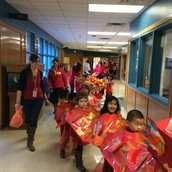 PK3 classes participates in a Chinese New Year parade.