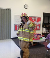 Ms. Pat Walking in a Fire Fighters Boots