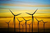Wind turbines in a sunset