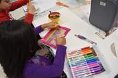 Ayesha creating her Gratitude Journal